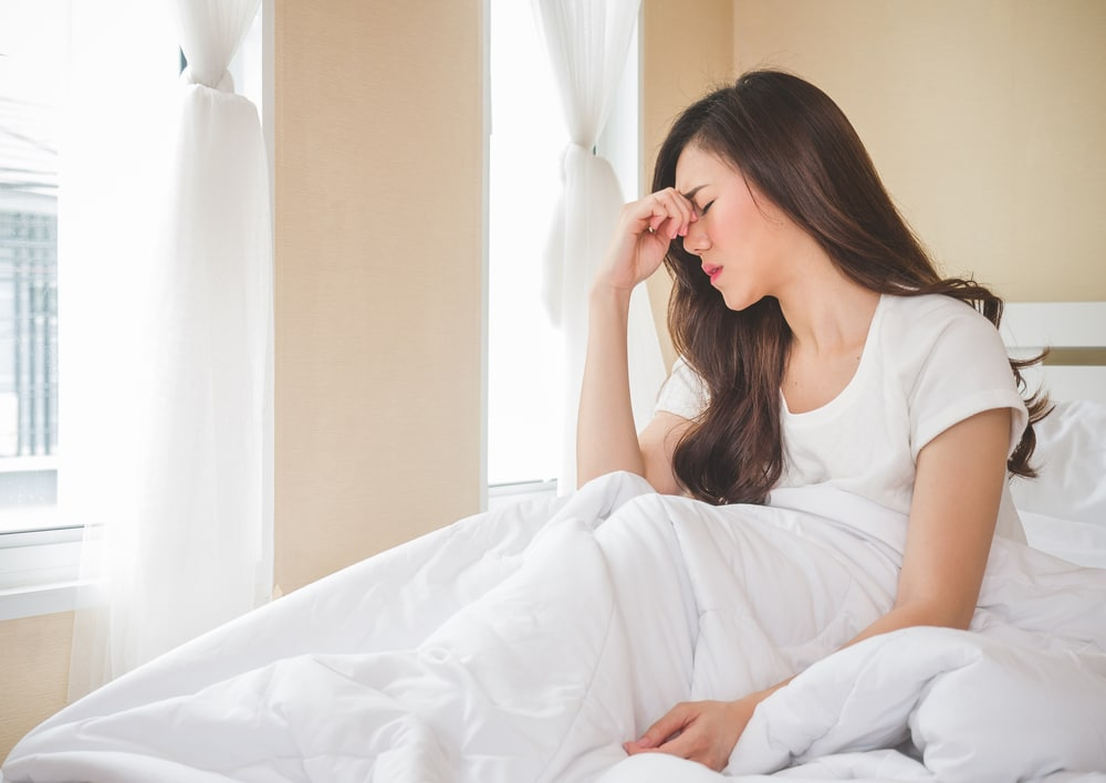 best mattresses for fibromyalgia - woman on bed with pain