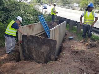 Excavation underway for water service tap.