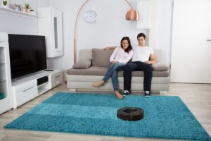 Vacuum cleaner on living room carpet