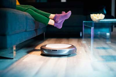Roomba Robot Vacuum Cleaner cleaning the house