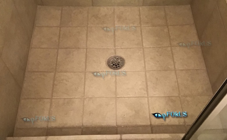 What floor cleaner is good to remove oily residues and soap stains from bathroom tiles?