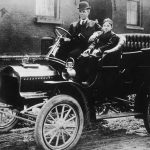 Henry Ford drives an early car