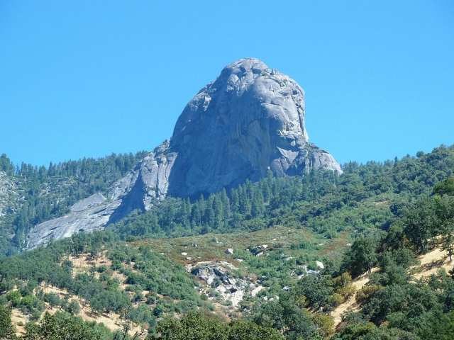 Moro Rock from far away. A staircase is leading to the summit of the rock