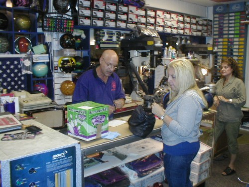 Ray DiSanto, Jr., owner of USA Bowling Pro Shops (and my coach) helping an unknown customer.  His wife Anna is in the right edge of the photo.