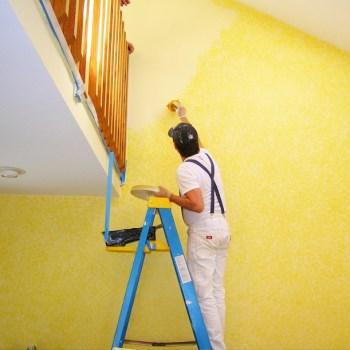Handyman painter on a ladder