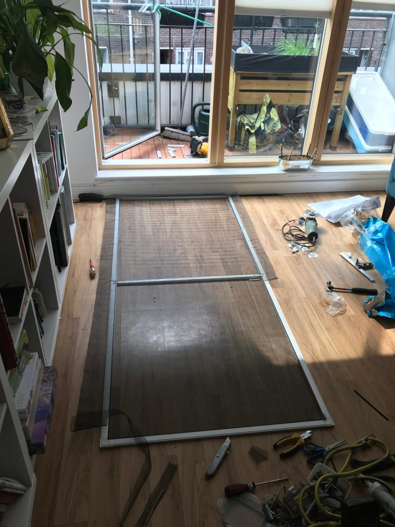 Fly screen door laying down for mesh installation