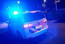 politie auto met zwaailicht