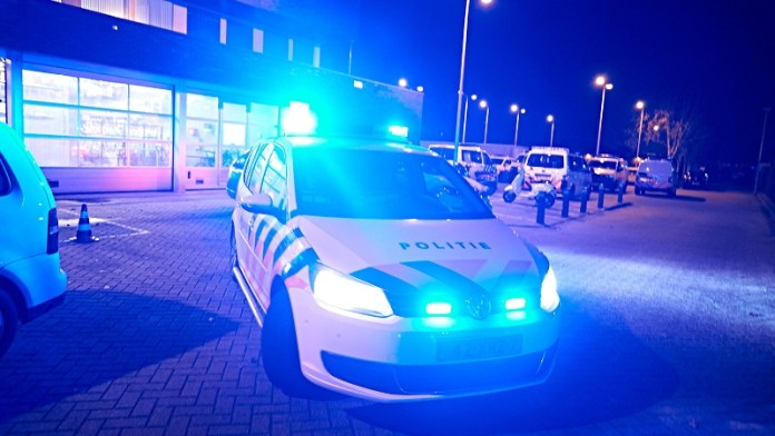 Politieauto met zwaailicht