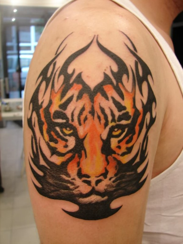 tribal angry face tiger tattoo