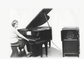Louise Coupleux (sister of Eloi) playing an amplified Télépiano in c1922