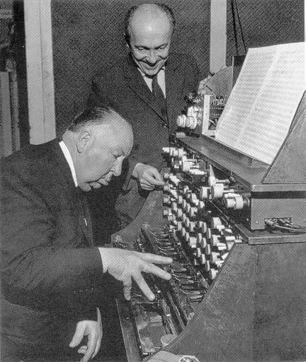 "Oskar Sala and Alfred Hitchcock working on the sound effects for ""The Birds"""