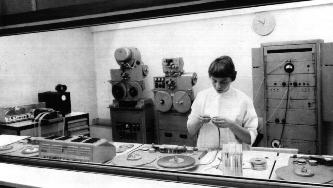 The machine room at the 'Studio for Electronic Music' (L-R:punch-paper controller, 2 four channel magnetic tape recorders, 'Bildabtaster' picture-scanner.  Foreground:2 Master magnetic tape machines)