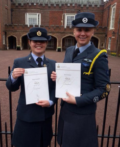 Sergeant (ATC) Megan Saunders and Cadet Warrant Officer Katie Dickson with their certificates outside St. James' Palace in London.