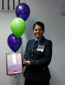 Flt Lt Burnham with trophy and nomination certificate