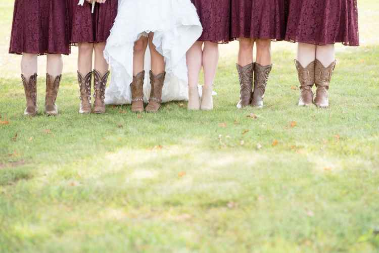 five women wearing brown leather cowboy boots