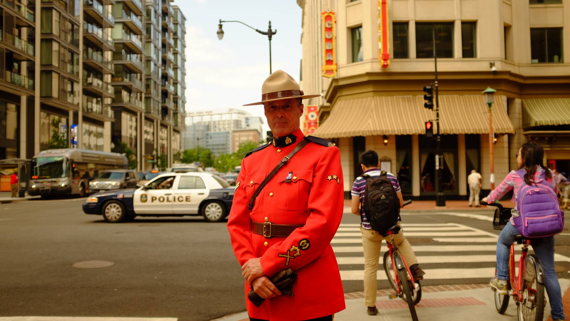 man in uniform standing on sidewalk