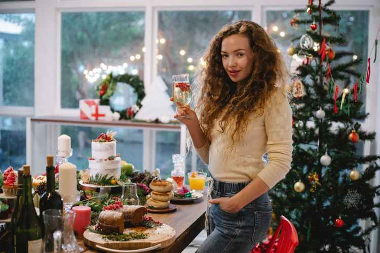 woman with champagne celebrating new year holiday at home