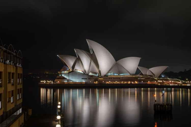 futuristic geometric exterior design of sydney opera house at night