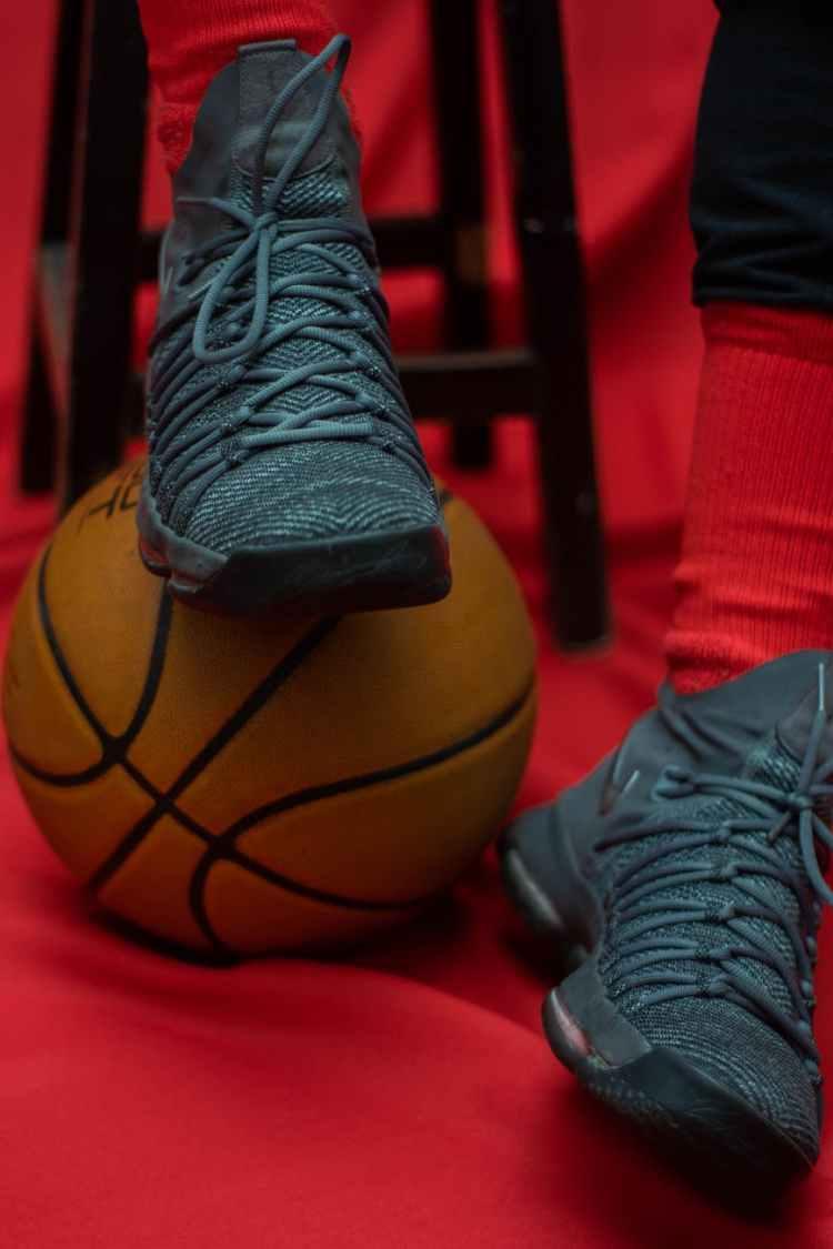 person wearing black nike basketball shoes
