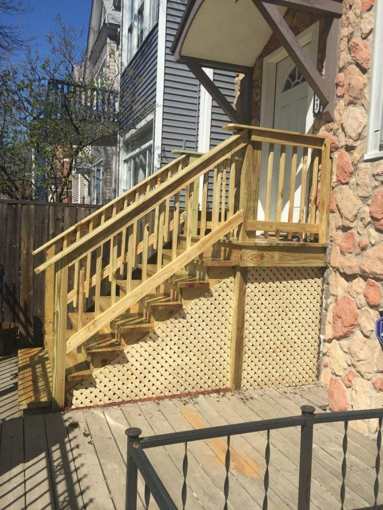 Bucktown wooden porch staircase renovation chicago il 123 the severely weather damaged porch and staircase had caused multiple areas of rotted wood as well as cracked wooden planks the homeowner was faced with a baanklon Images