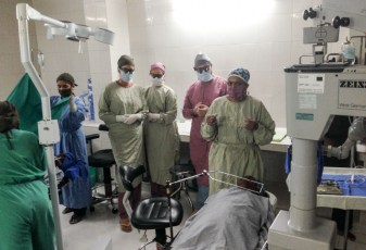 Operating room at Goutami Eye Hospital showing 2 patients prepared for simultaneous surgery by Dr. Madhavi (far right) and Dr. Hertle (second from right) along with the surgical nursing staff.