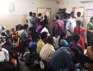 Waiting room outside the pediatric clinic at the Goutami Eye Hospital, Rajahmundry, India prior to starting office hours filled with almost 150 patients.