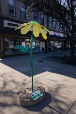 The Green-Headed Coneflower sculpture stands tall at 7 ft. in downtown Wadsworth.