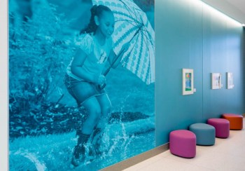 Our ER's puddle theme features a calming blue color palette, splashes of artwork, ripple patterns in the flooring, an aquarium and other playful touches.