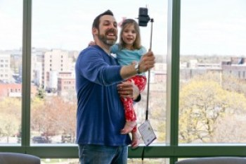 Chris and Bekah have fun with the selfie-stick, a popular giveaway at the event