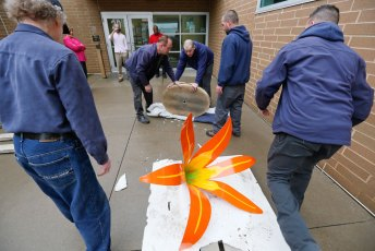 Andrew's Moving & Storage crew unloads the Daylily sculpture at the Akron Urban League