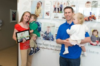 Jordan Pollock was born with spina bifida. He's celebrating his Wall of Hope display with his mom, Megs, dad, Randy, and little sister, Gabriella.