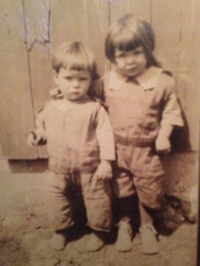 Sis with her little brother, the late Richard Karg in front of the barn at the farm.