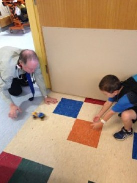 Neurologist Thomas Enlow plays with Caleb in the EMU