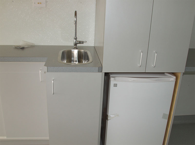 Refrigerator and sink inside Alcor transport vehicle