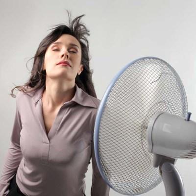 Woman standing in front of a fan.