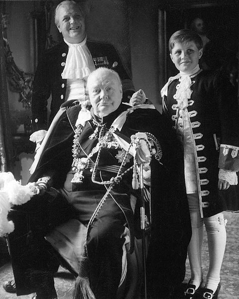 """Three generations, now sadly all gone, in court dress for the Coronation of Queen Elizabeth II: Randolph, Sir Winston, and """"young Winston,"""" 1953 (Toni Frissell/Wikimedia Commons)"""