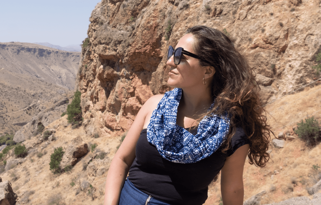 Kate wears a blue and white patterned scarf, available from Speakeasy.
