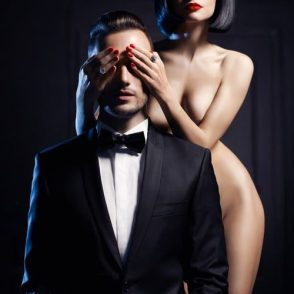 domme clothing the eyes of a submissive