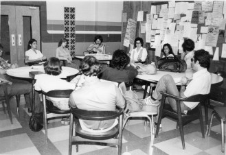 students at desks in a meeting