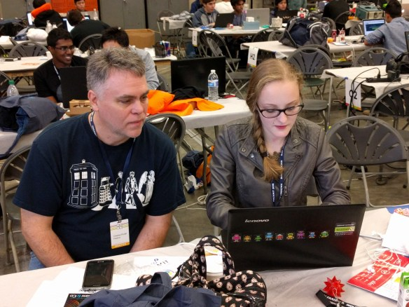 May Tomic works on her team's project, Conversationalist at HackMIT