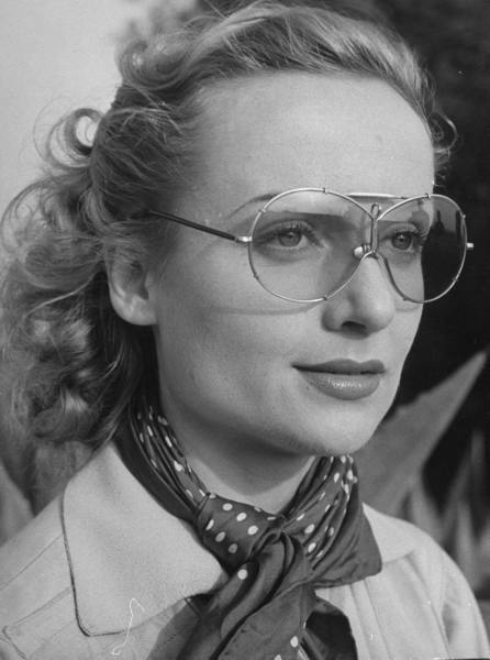 starsofyesterday: Carole Lombard wearing glasses for a skeet shooting at a gun club.