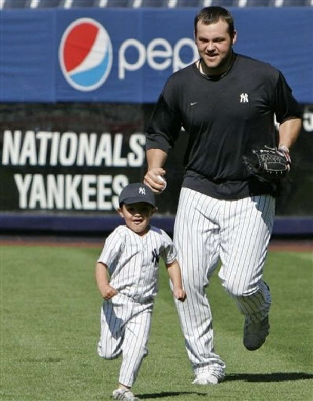 Joba chases his son Karter after the game. Cute!