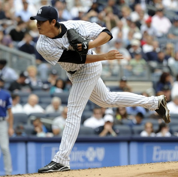 4.2 innings, 7 hits, 5 earned runs, 1 walk, and 5 strike outs. Ehh, the important thing is that the Yanks won.