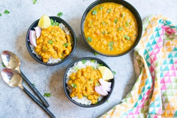Chana Dal made in pressure cooker served in a bowl and topped on rice