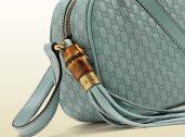 Disco bag Sunshine - blu chiaro - dettaglio nappina con bambù