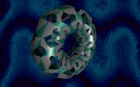 Un tore dans quasiment la même perspective, mais cette fois avec un effet de masque qui est je suppose apposé sur la texture plutôt que sur la géométrie. À noter aussi, un effet 2D très sympathique en arrière plan. Believe par Valhalla (MS-DOS, 1996) https://demozoo.org/productions/7383/