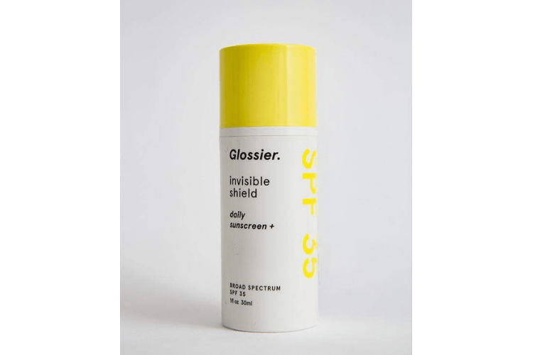 Bottle of Glossier Invisible Shield Daily Sunscreen.