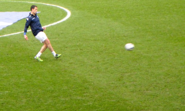 Fahey back kicking a ball