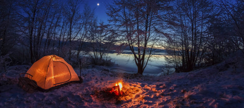 camp by the lake at night
