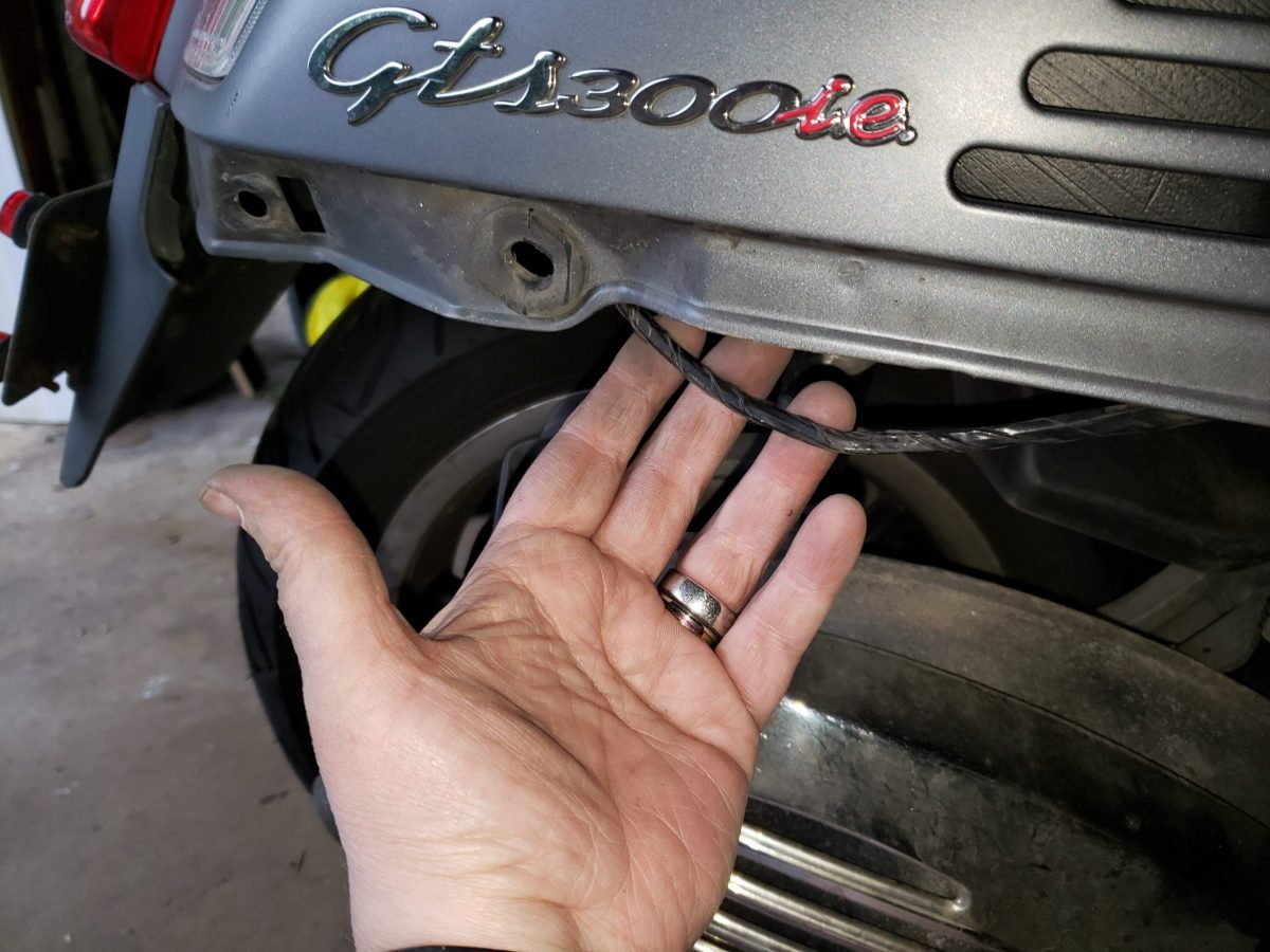 exposing the wire after pulling the scooter lower panel off